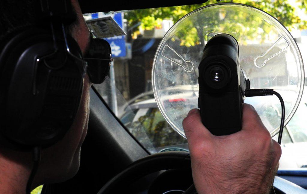 private investigator inside the car with surveillance camera