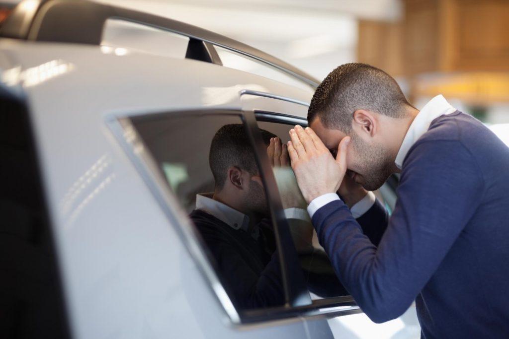 man looking at the tinted car